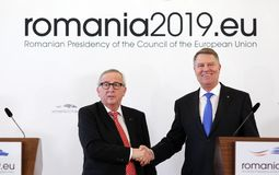 KLAUS IOHANNIS AND JEAN-CLAUDE JUNCKER MEETING AT COTROCENI PALACE. Romanian President Klaus Iohannis, right and Jean-Claude Juncker the President of the stock image