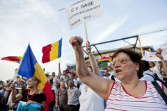 Romanian protesters. People shout during a rally in Bucharest, protesting against Romania's President Traian Basescu, after romanian lawmakers debated a motion Royalty Free Stock Images