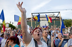 Romanian protesters. People shout during a rally in Bucharest, protesting against Romania's President Traian Basescu, after romanian lawmakers debated a motion Royalty Free Stock Photo