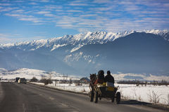 Romanian road with horse carriage and winter scene Royalty Free Stock Photo
