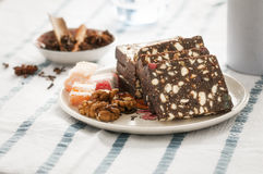 Romanian salami Cake with cocoa, turkish delight and walnuts stock photo