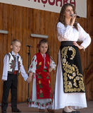 Romanian singer and children, in traditional costume Stock Images