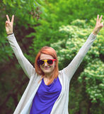 Romanian soccer fan with funny sun glasses in nature Royalty Free Stock Photo
