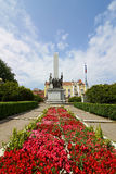 Romanian Soldier Monument in Cluj, Romania. Symmetrical shot in Cluj, Romania with the Romanian Soldier Monument in Avram Iancu square. Some flowers in the Royalty Free Stock Photo