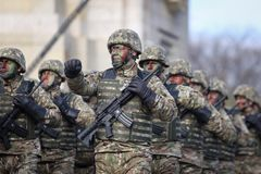 Romanian special forces soldiers, armed with M4A1 5.56×45mm NATO assault rifles. Bucharest, Romania - December 1, 2018: Romanian special forces soldiers royalty free stock photos