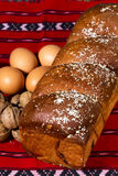 Romanian sponge cake, eggs, walnuts -conceptual image-on red tra Stock Images