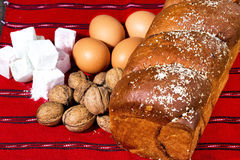 Romanian sponge cake and ingredients, eggs, walnuts, jelly Stock Image