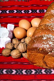 Romanian sponge cake and ingredients, eggs, walnuts, jelly,on Royalty Free Stock Photos