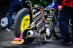 A romanian team mechanic prepares one of the riders motorbikes ahead of the first heat of their 2014  National Championship campai Royalty Free Stock Photo