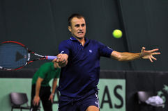Romanian tennis player Marius Copil in action Stock Photo