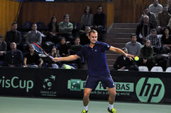 Romanian tennis player Marius Copil in action Stock Photography
