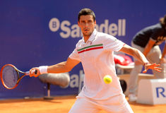 Romanian tennis player Victor Hanescu. In action during his match against David Ferrer  of Barcelona tennis tournament Conde de Godo on April 21, 2011 in Royalty Free Stock Image