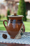 Romanian traditional ceramic pitcher on a table Stock Photography