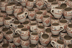 Romanian traditional clay cups. These are finished romanian traditional clay cups. They are ready for the customers. They were made on the potters wheel and they Royalty Free Stock Photography