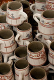 Romanian traditional clay cups. These are finished romanian traditional clay cups. They are ready for the customers. They were made on the potters wheel and they Royalty Free Stock Photos