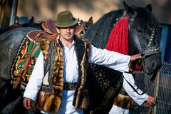 Romanian traditional costume in Bucovina county on celebration time. With horse royalty free stock photography
