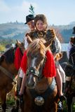Romanian traditional costume in Bucovina county on celebration time. With horse stock photos