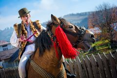 Romanian traditional costume in Bucovina county on celebration time stock photography