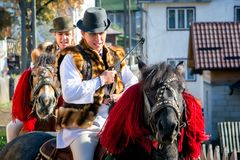 Romanian traditional costume in Bucovina county on celebration time. With horse stock image