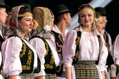 Romanian traditional dance with specific costumes 2 Royalty Free Stock Image