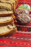 Romanian traditional easter sponge cake and nicely decorated easter eggs. East european orthodox tradition Royalty Free Stock Photography