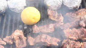 Romanian traditional food - bulz and grilled smoked pork stock footage
