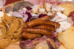 Romanian traditional food for Christmas. Ham, sausage and mealball on banquet wooden dish Royalty Free Stock Photography