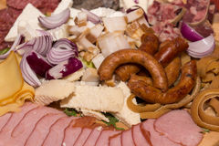 Romanian traditional food for Christmas. Ham, sausage and mealball on banquet wooden dish Royalty Free Stock Image