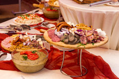 Romanian traditional food for Christmas. Ham, sausage and mealball on banquet wooden dish Stock Images