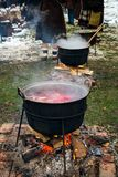 Romanian traditional food prepared at the cauldron on the open fire. Christmas tradition stock photography