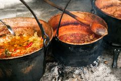 Romanian traditional food prepared at the cauldron on the open fire. Close view stock images