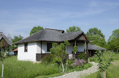 Romanian traditional house. Photo was taken at the Museum Golesti the only outdoor museum in Romania. In the image is a Romanian traditional house Stock Photo