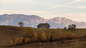 Isolated traditional Romanian houses built somewhere in a valley in Transylvania royalty free stock photography