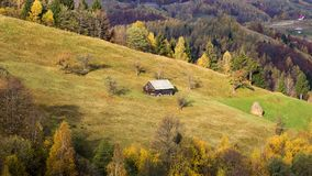 Isolated traditional Romanian houses built somewhere in a valley in Transylvania stock photos