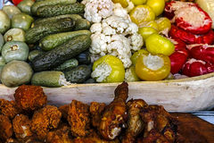 Romanian traditional pickles, meatloaf and chicken fried meat Stock Image