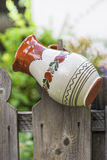Romanian traditional pot. Traditional ceramic pot hanging on a wooden fence Royalty Free Stock Photo