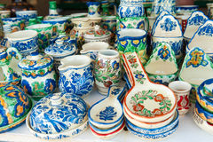 Romanian traditional pottery handcrafted mugs and plates at a souvenir shop Stock Images