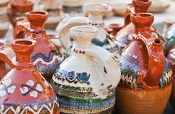 Romanian traditional pottery handcrafted mugs at a souvenir shop. Romanian traditional handcrafted pottery jugs to be sold Stock Image
