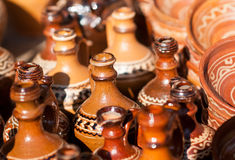 Romanian traditional pottery handcrafted mugs at a souvenir shop. Romanian traditional handcrafted pottery Royalty Free Stock Images