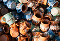 Romanian traditional pottery handcrafted mugs at a souvenir shop. Romanian traditional handcrafted pottery Stock Photography