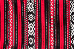 Romanian Traditional red carpet. Detail of traditional romanian carpet - red theme background Stock Photography