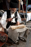 Romanian traditional sandal maker. Is showing how old sandals worn by romanian peasants is done. This took place in Craiova, Romania at Craiova days in 2012 Royalty Free Stock Images
