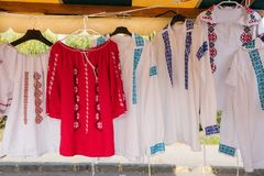Romanian traditional shirts on hangers Stock Photo