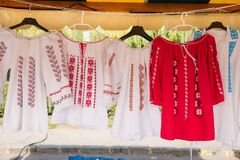 Romanian traditional shirts on hangers Royalty Free Stock Images