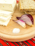 Romanian traditional snack of cheese onion and bread on a wooden plate Royalty Free Stock Images