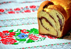 Romanian traditional sponge cake. On a traditional towel Royalty Free Stock Image
