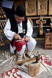 Romanian traditional wood carver. Romainian tradditional wood carver is showing how wooden spoons were made in the past. The demonstration were performed in Stock Photos