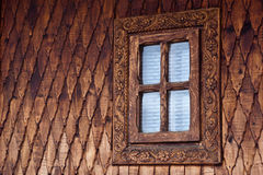 Romanian traditional wooden church window. Romanian traditional wooden churches are decorated with hand made carvings. Notice the craftsmanship of the people who Stock Photos