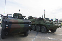 Romanian and US APC with the NATO Caravan. A Romanian Army Mowag Piranha IIIC 8x8 armoured personnel carrier and an United States Army M1126 Infantry Carrier Stock Photos