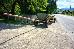 Wooden cart near the road Royalty Free Stock Image